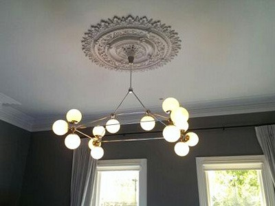Light fitting painting coving